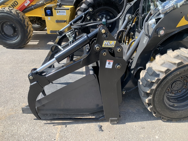 New Holland L318 skid steer loader with grapple