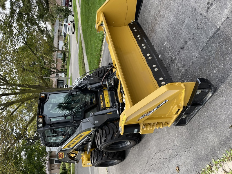 New Holland L230 Skid Steer with Edge Flex snow wing