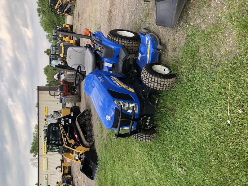 New Holland Boomer 1020 tractor with mower
